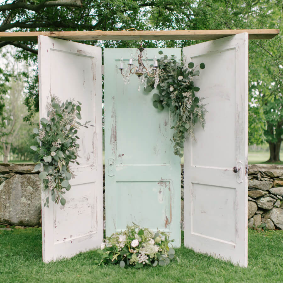 Beau Three Door Rustic Backdrop (with Chandelier) | Uniquely Chic Vintage Rentals