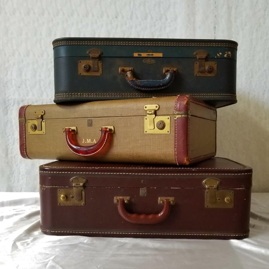 Multicolored Vintage Suitcases | Uniquely Chic Vintage Rentals