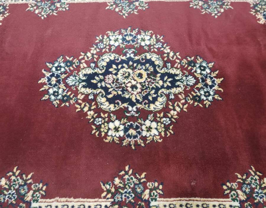 Red Rug with Blue Trim (Detail) | Uniquely Chic Vintage Rentals